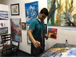 Artist and tenant Rahendra K.C. perfects one of his watercolors in his studio space at Art and Frame of Falls Church.