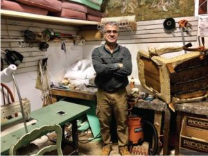 Farhad Keyvani of Kian Furniture poses in his Art and Frame of Falls Church studio space.