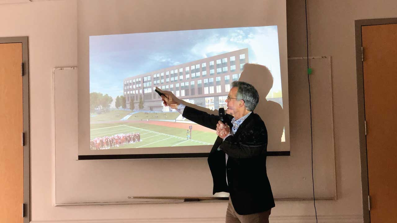 Derk Jeffrey, Senior Principal at Stantee and lead architect of the development project describes a rendering of the new high school building.